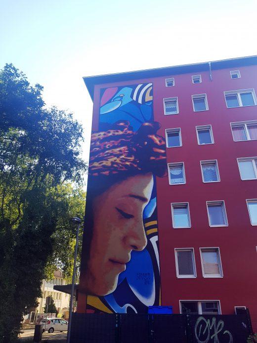 Das Foto zeigt die Murals von SineroJan Schoch und Olli Rose am Springerplatz 40