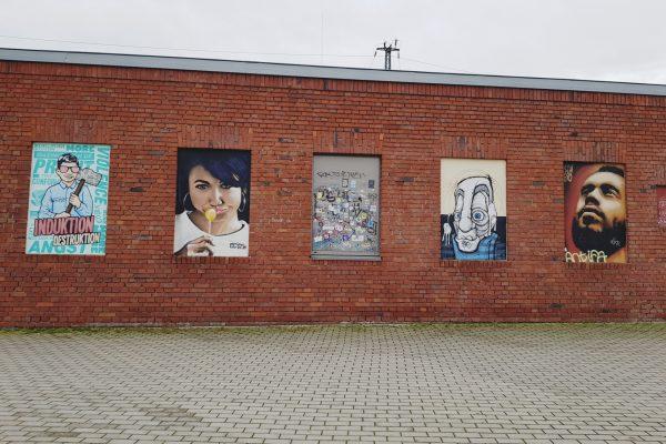 Das Foto zeigt Portrait Graffitis an der Rotunde in Bochum