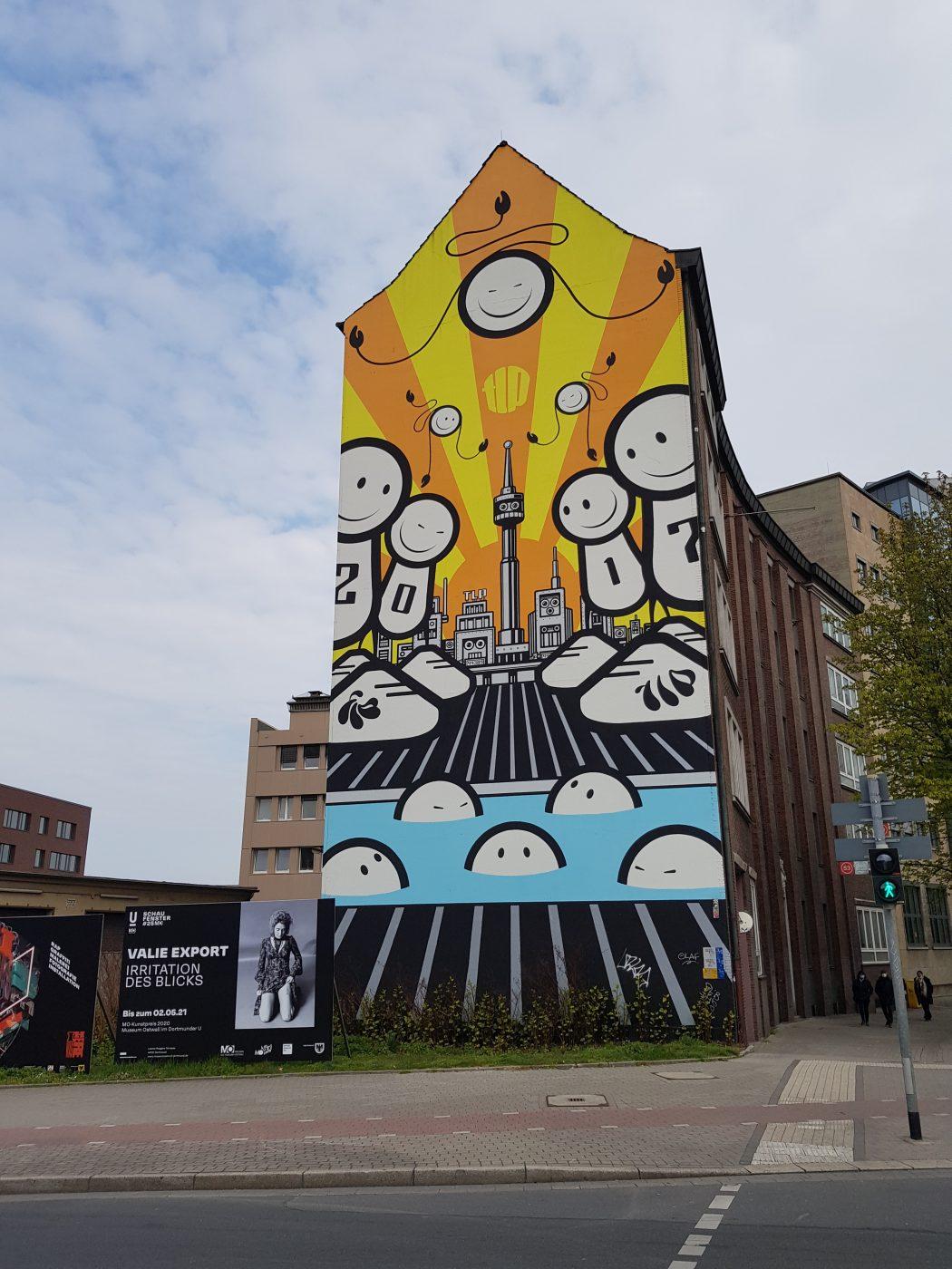 Das Foto zeigt Streetart auf einer Hauswand in der Nähe des Dortmunder Us